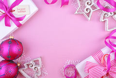 Modern festive pink theme Christmas holiday background with deco. Rated borders on pink wood table royalty free stock photography