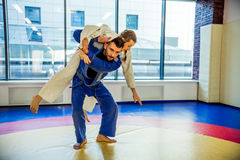 Modern fight club. Two judo fighters showing technical skill while practicing Martial arts in a fight club Stock Photos