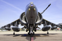 Modern fighter jet, shallow depth of field. Worm's eye view of Harrier jump jet on runway with lensbaby/tilt shift style shallow depth of field Royalty Free Stock Images