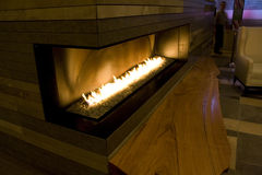 Modern fireplace. A big modern fireplace in a hotel Stock Images