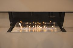 Modern fireplace built into the wall, a rooftop fireplace luxury style stock photos