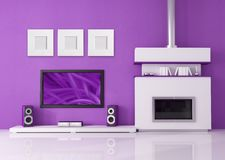 Modern fireplace and home cinema. Contemporary fireplace with lcd tv and speaker in a purple lounge -- the image on screen is a my photo Royalty Free Stock Photo