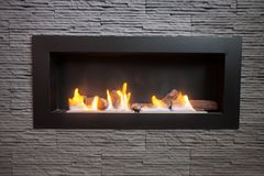 Modern fireplace. Modern indoor fireplace on biofuel Royalty Free Stock Image