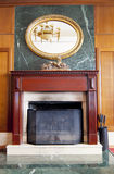 Modern fireplace in wooden and marble interior Stock Image