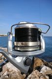 Modern fishing reel Royalty Free Stock Image