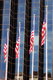 Modern Flags. Four US flags raised in front of a modern office tower in San Antonio, Texas Stock Images