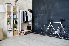 Modern Flat Interior. Background image of empty apartment with bicycle next to chalkboard wall, copy space Royalty Free Stock Images