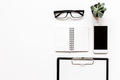Modern flat lay with office items on white desk background top view mockup. Modern flat lay with office items for work on white desk background top view mockup Royalty Free Stock Photos