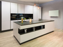 Modern flat white kitchen Royalty Free Stock Photography