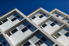Modern flats or apartments. Low angled view of modern flats or apartments with blue sky background Royalty Free Stock Photos
