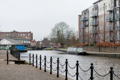 Modern Flats and the Canal. The modern construction flats alongside the canal Royalty Free Stock Photography