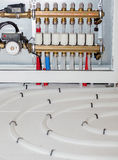 Modern floor heating system. Modern floor heating system map with accesories - closeup Stock Images