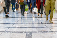 A modern floor with legs of a crowd in the background Royalty Free Stock Image