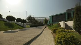 Modern football stadium and the academy next to it, general shot stock footage