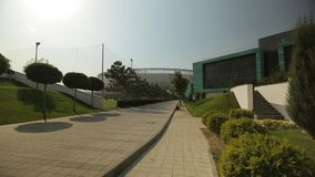 Modern football stadium and the academy next to it, general shot 2 stock video