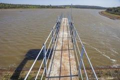 Modern footbridge attached to Dam of Cornalvo Reservoir Royalty Free Stock Image