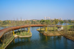 Modern footbridge over lake in sunny winter morning. Modern footbridge over the water in sunny winter morning,Chengdu,China Stock Images