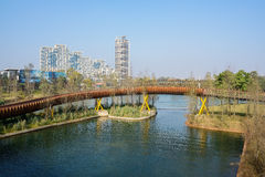 Modern footbridge over water in sunny winter morning. Modern footbridge over the water in sunny winter morning,Chengdu,China Stock Photos