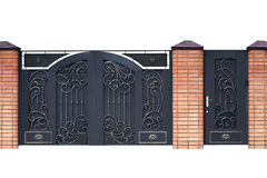 Modern  forged  decorative  gates. Royalty Free Stock Images