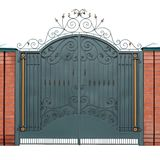 Modern forged gates with overlaid ornaments. Royalty Free Stock Photo