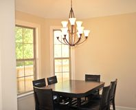 Modern Formal Lighting Fixture. In modern suburban home Dining room Stock Images