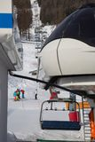 Modern Four-seater Ski Lifts in Italian Dolomites Alps in Winter Day with Snow.  royalty free stock photo