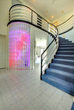 Modern foyer with glass block wall trim Royalty Free Stock Image