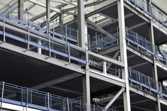 Steel framed building under construction with blue railings. Modern framed building under construction with blue railings Stock Photos
