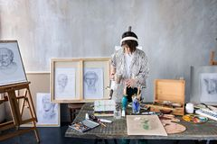 Young student artist at art workplace royalty free stock photography