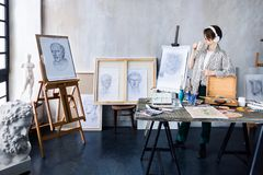 Young student artist at art workplace royalty free stock images