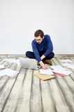 Modern Freelancer Working with Laptop on Floor Stock Image