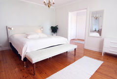 Modern Fresh Bedroom. In white colors royalty free stock image
