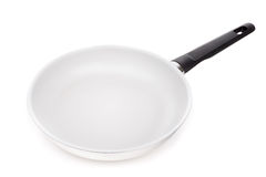 Modern frying pan for pancakes, in horizontal mode. On a white background royalty free stock photo
