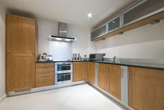 Modern fully fitted kitchen. Contemporary fully fitted kitchen with modern appliances Royalty Free Stock Images
