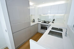 Modern fully fitted kitchen. With appliances in white Stock Photography