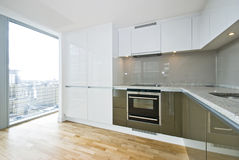 Modern fully fitted kitchen. With kitchen appliances in army green and white Stock Images