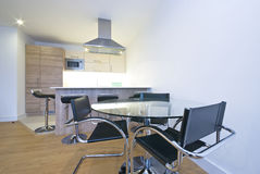 Modern fully fitted kitchen with dining area Stock Photography