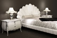 Modern furniture. Bed with furry counterpane Royalty Free Stock Photography