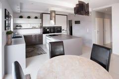 Modern furniture in designed kitchen Stock Images