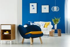 Modern furniture in living room. Modern furniture in blue and white living room stock photography