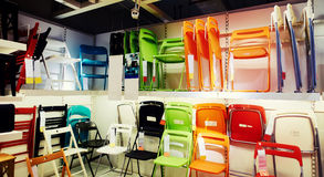 Furniture store shop. Chairs in modern furniture retail store. Chair on sale in shop Stock Photography