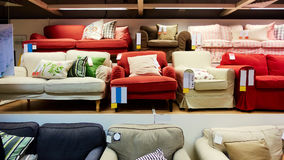 Furniture store shop. Sofa in modern furniture retail store. Sofa with cushion on sale in shop Royalty Free Stock Photos