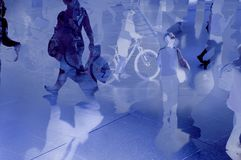 Modern and future city with commuters. Abstract modern city with commuters people walking over reflections. Composite image Royalty Free Stock Photo
