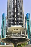 Modern futuristic building. A fountain lies between the photographer and the building. The picture shws a mdern high rise luxury condominium near completion Royalty Free Stock Photo