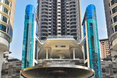 Modern futuristic building. A fountain lies between the photographer and the building. The picture shws a mdern high rise luxury condominium near completion Stock Photography