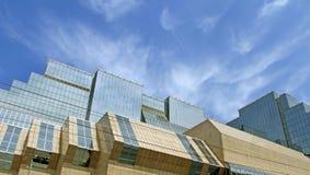 Modern futuristic building. Under blue sky royalty free stock photo