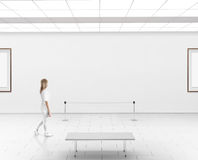 Modern gallery wall mockup. Woman walk in museum hall. With blank wal with frames. White clear stand mock up show. Display artwork presentation. Art design Royalty Free Stock Photos