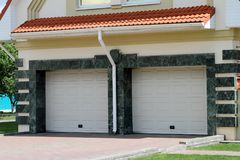 Modern Garage door for 2 cars. Royalty Free Stock Photos