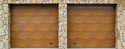 Modern garage door. Large automatic up and over garage door with inclusion of smaller personal door. Modern garage door. Large automatic up and over garage door stock image
