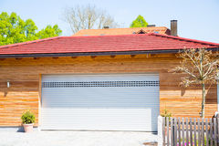 Modern garage, white, wooden cladding Royalty Free Stock Images